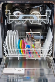 Picture of an open dishwasher with clean dishes